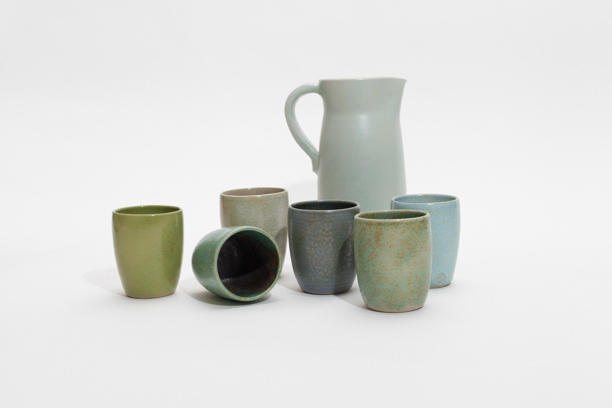 Jar with mugs in six shades of blue, green and grey