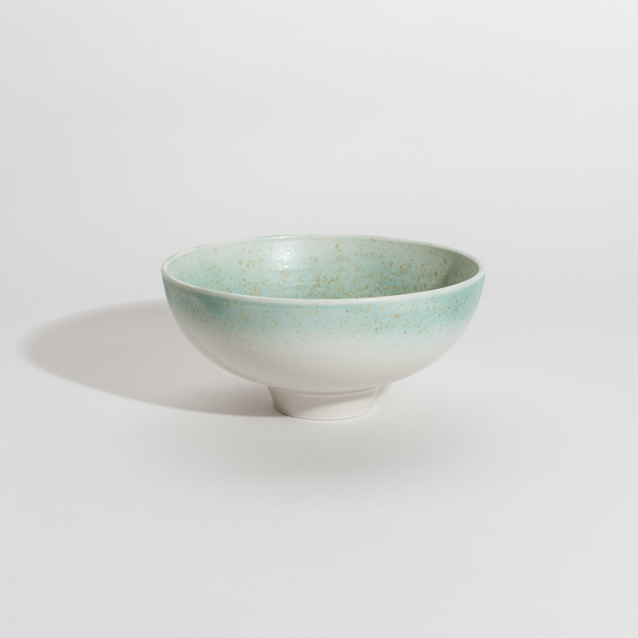 Porcelain bowl with green speckle glazed edge
